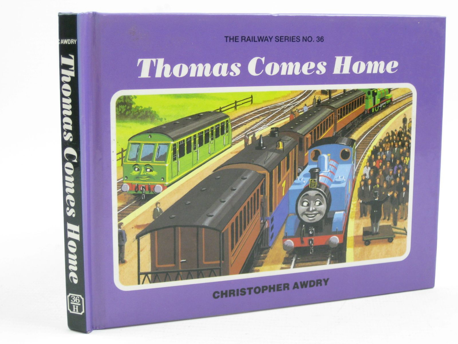Photo of THOMAS COMES HOME written by Awdry, Christopher illustrated by Spong, Clive published by Heinemann (STOCK CODE: 1316751)  for sale by Stella & Rose's Books