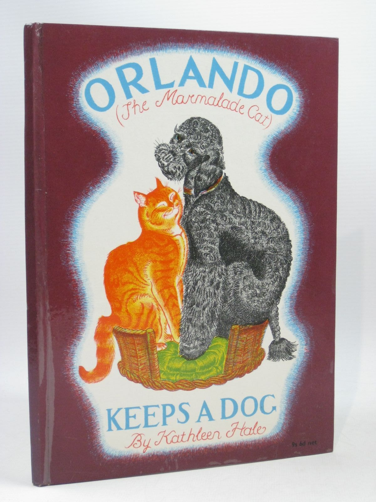 Photo of ORLANDO (THE MARMALADE CAT) KEEPS A DOG