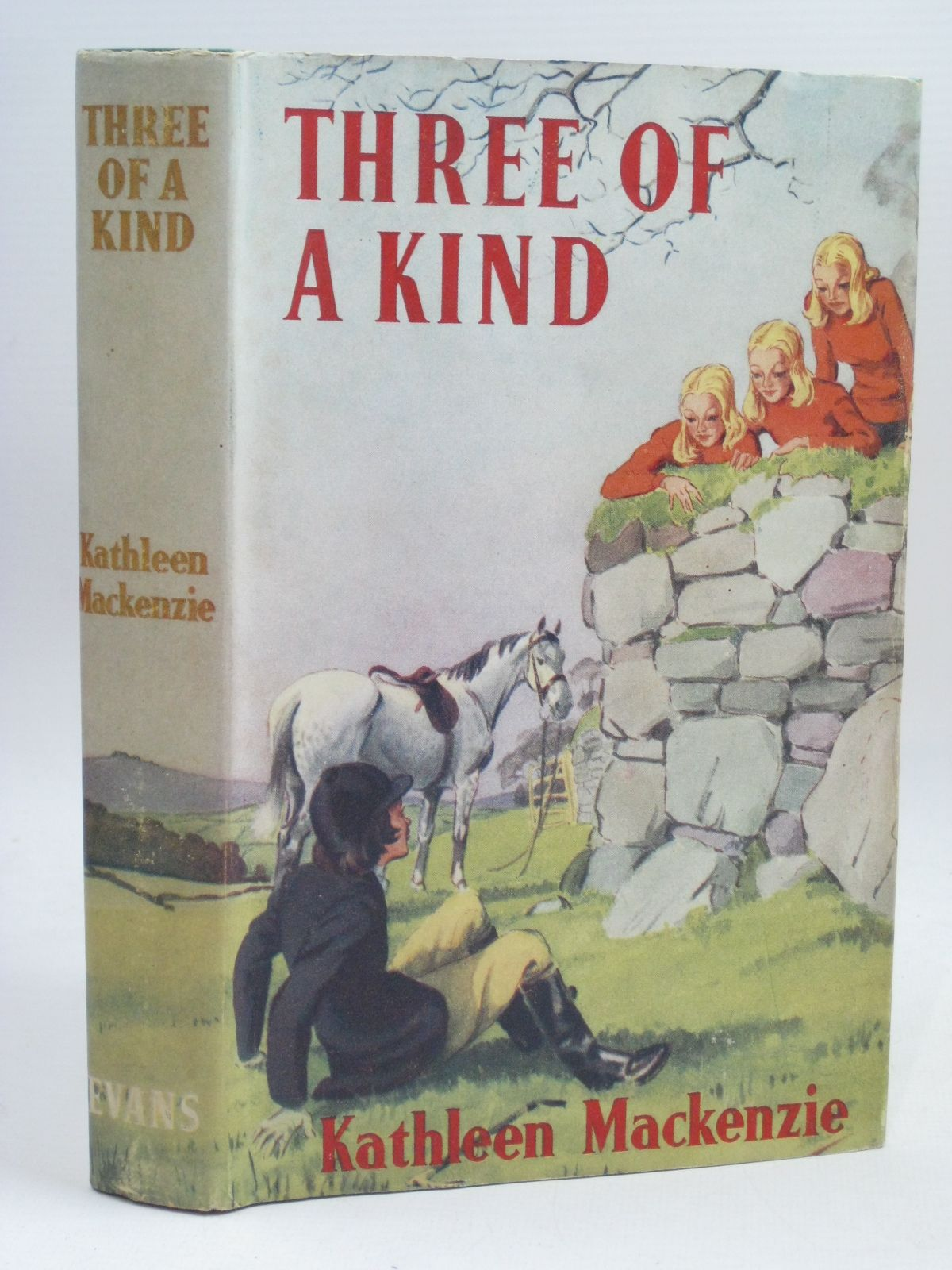 Photo of THREE OF A KIND written by MacKenzie, Kathleen illustrated by Morgan, Violet published by Evans Brothers Limited (STOCK CODE: 1506361)  for sale by Stella & Rose's Books
