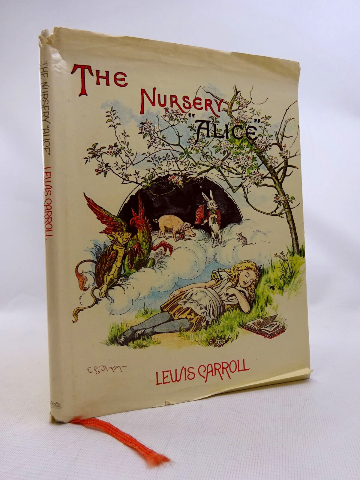 Photo of THE NURSERY ALICE written by Carroll, Lewis illustrated by Tenniel, John<br />Thomson, E. Gertrude published by MacMillan Publishers Ltd., Godfrey Cave (STOCK CODE: 1816771)  for sale by Stella & Rose's Books