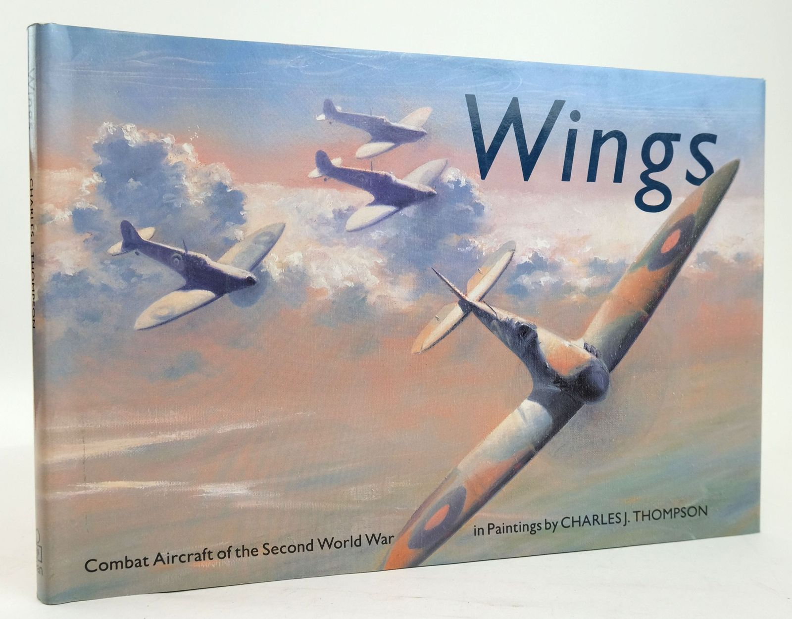 Photo of WINGS: COMBAT AIRCRAFT OF THE SECOND WORLD WAR IN PAINTINGS written by Thompson, Charles J. illustrated by Thompson, Charles J. published by Pan Books (STOCK CODE: 1820204)  for sale by Stella & Rose's Books