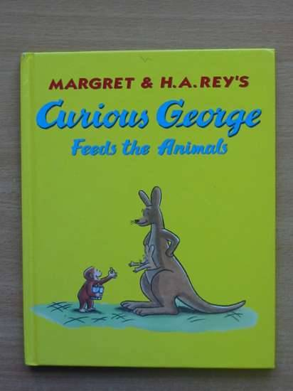 Photo of CURIOUS GEORGE FEEDS THE ANIMALS- Stock Number: 569552